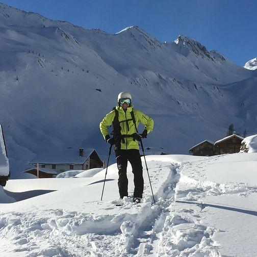 Ski tour through a hut village